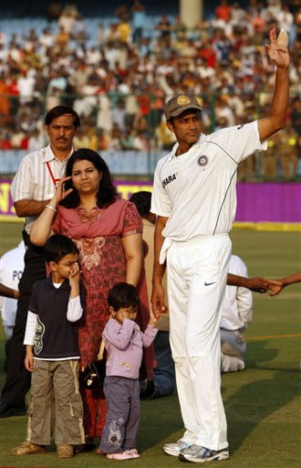 Indian cricket team captain Anil Kumble, right, waves at the crowd as he waits for the presentation ceremony with his wife Chetana and children on the final day of the third test cricket match between India and Australia, in New Delhi, India, Sunday, Nov. 2, 2008. Kumble, the third most successful bowler in test history with 619 wickets, announced his retirement at the end of the third test against Australia. (AP Photo/Saurabh Das)
